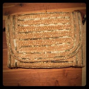 Gold wicker clutch